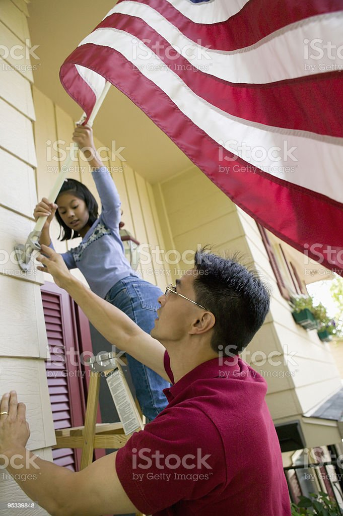 Raising the flag at home stock photo