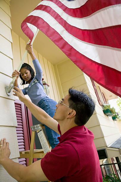 Raising the flag at home stock photo