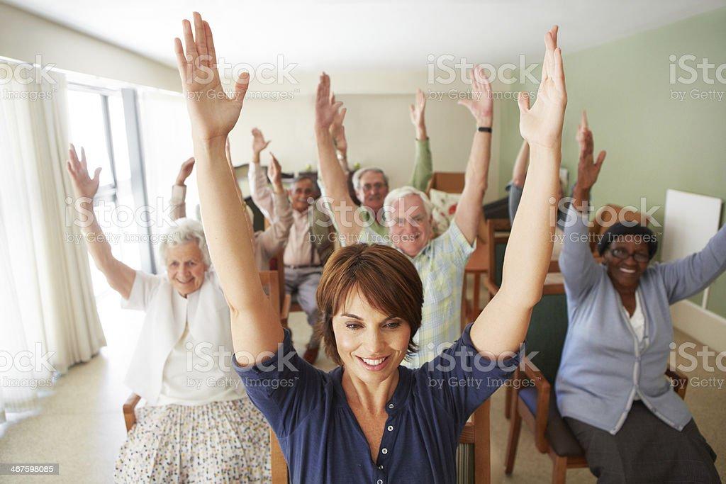 Raising their arms up high stock photo