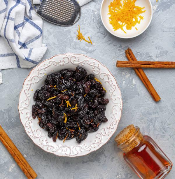 Raisins and orange zest soaked in rum. stock photo