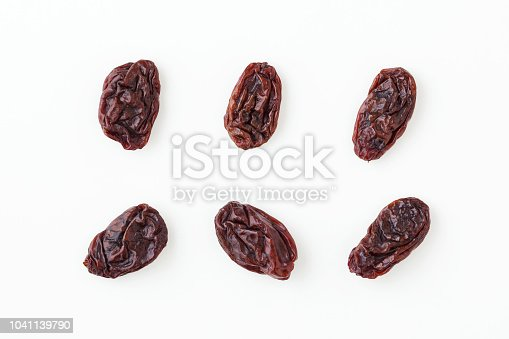 Raisins isolated on white background, top view