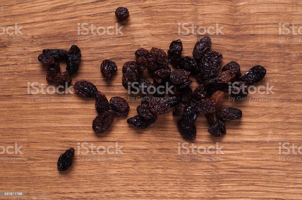 raisins on brown wooden table stock photo