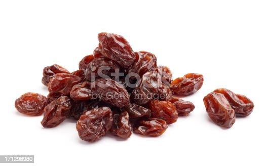 heap of raisins isolated on white background