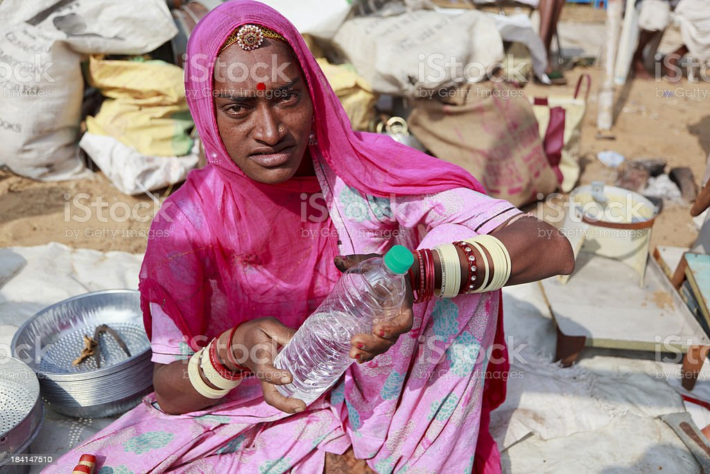 Rajasthan Market Woman with water. stock photo