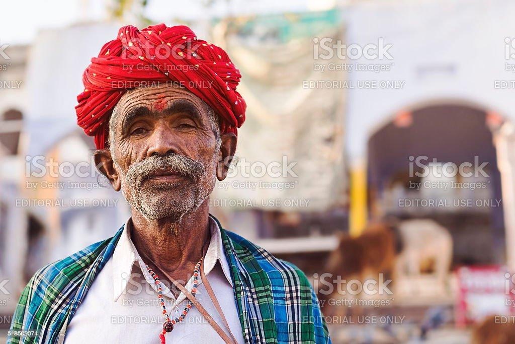 Rajasthani Man Wearing Traditional Red Turban in Pushkar, India stock photo
