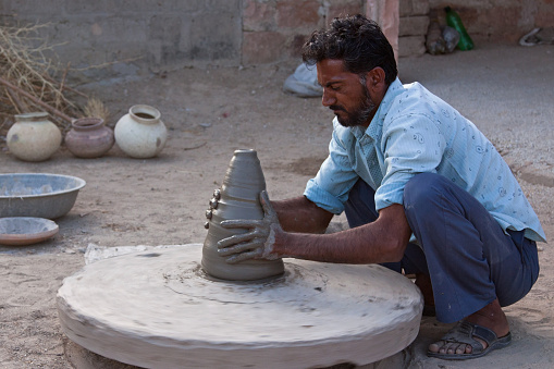 Rajasthani potter creating a domestic vessel using traditional techniques
