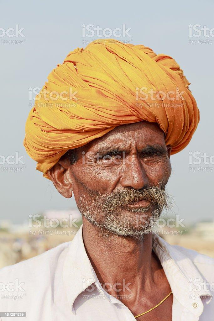 Rajasthani tribal man in yellow turban stock photo