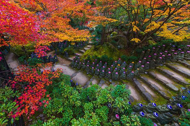 500 Rakan statues at Daishoin Temple Hatsukaichi, Hiroshima Prefecture, Japan - November 17, 2014: Daishoin Temple Miyajima of  autumn. Buddha of 500 bodies in the garden miyajima stock pictures, royalty-free photos & images