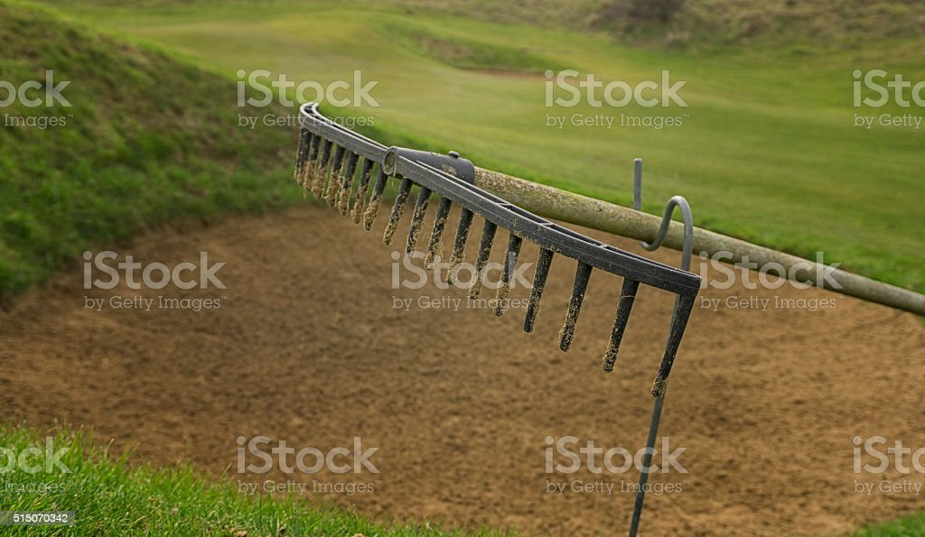 Rake head at the side of a golf bunker stock photo