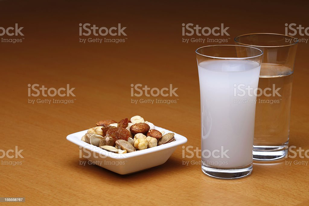 Raki and water with dried fruit royalty-free stock photo