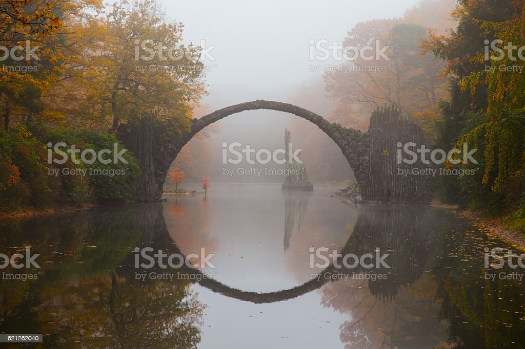 Rakotzbrücke (Devil's bridge) in early morning mist stock photo