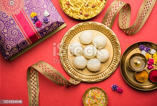 istock Raksha bandhan Festival : conceptual Rakhi made using plate full of Rasgulla sweet with band. A traditional Indian wrist band which is a symbol of love between Brothers and Sisters 1024534546