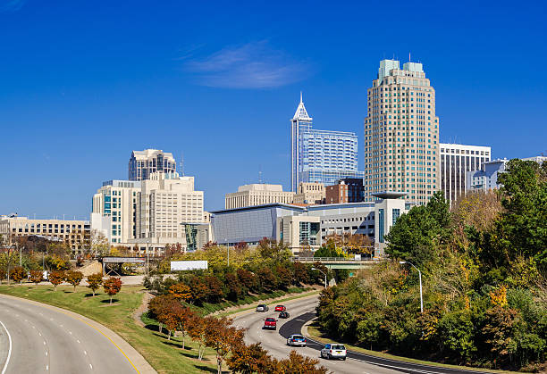 Raleigh downtown skyline and street lined with Autumn colored trees stock photo