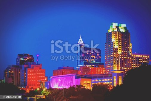 A vibrant downtown city skyline of Raleigh North Carolina in a hazy matte vignette.