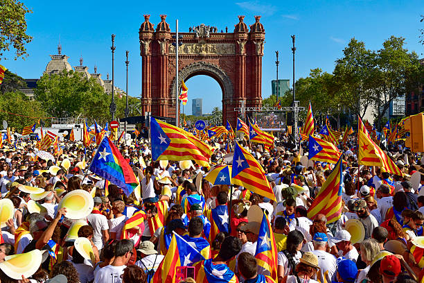 rally in support for the independence of Catalonia in Barcelona, Barcelona, Spain - September 11, 2016: People partaking in a rally in support for the independence of Catalonia in Barcelona, Spain, during its National Day catalonia stock pictures, royalty-free photos & images