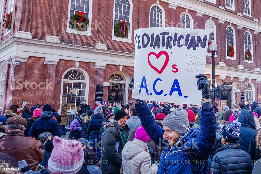 Rally to keep Obamacare in Boston stock photo