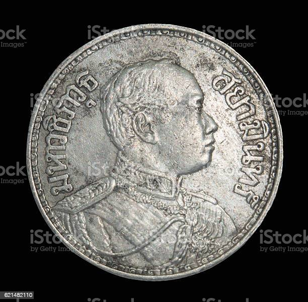 Rama IV coin Vajiravudh front isolated on black background, Thailand