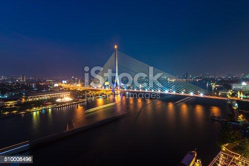 Rama VIII Bridge at night in Bangkok and Chopraya river in Bangkok
