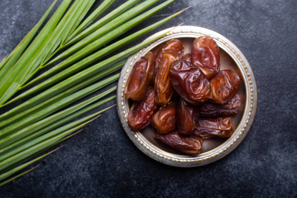 Ramadan dates is traditional food for iftar in islamic world Ramadan dates is traditional food for iftar in islamic world. Dark background date stock pictures, royalty-free photos & images