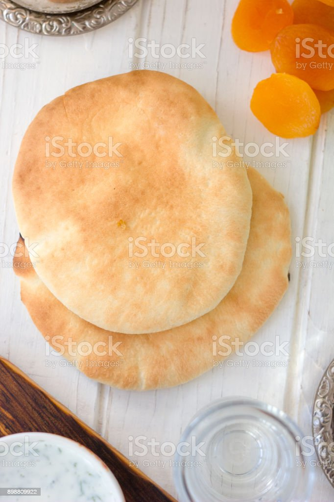 Ramadan food - pita bread for iftar time. stock photo