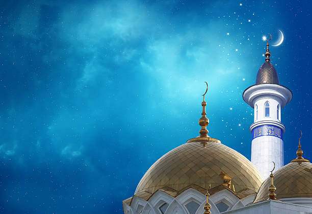 ramadan kareem background.crescent moon at a top of a mosque - eid stock pictures, royalty-free photos & images