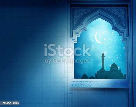 istock Ramadan Kareem background.Mosque window with shiny crescent moon 534552806