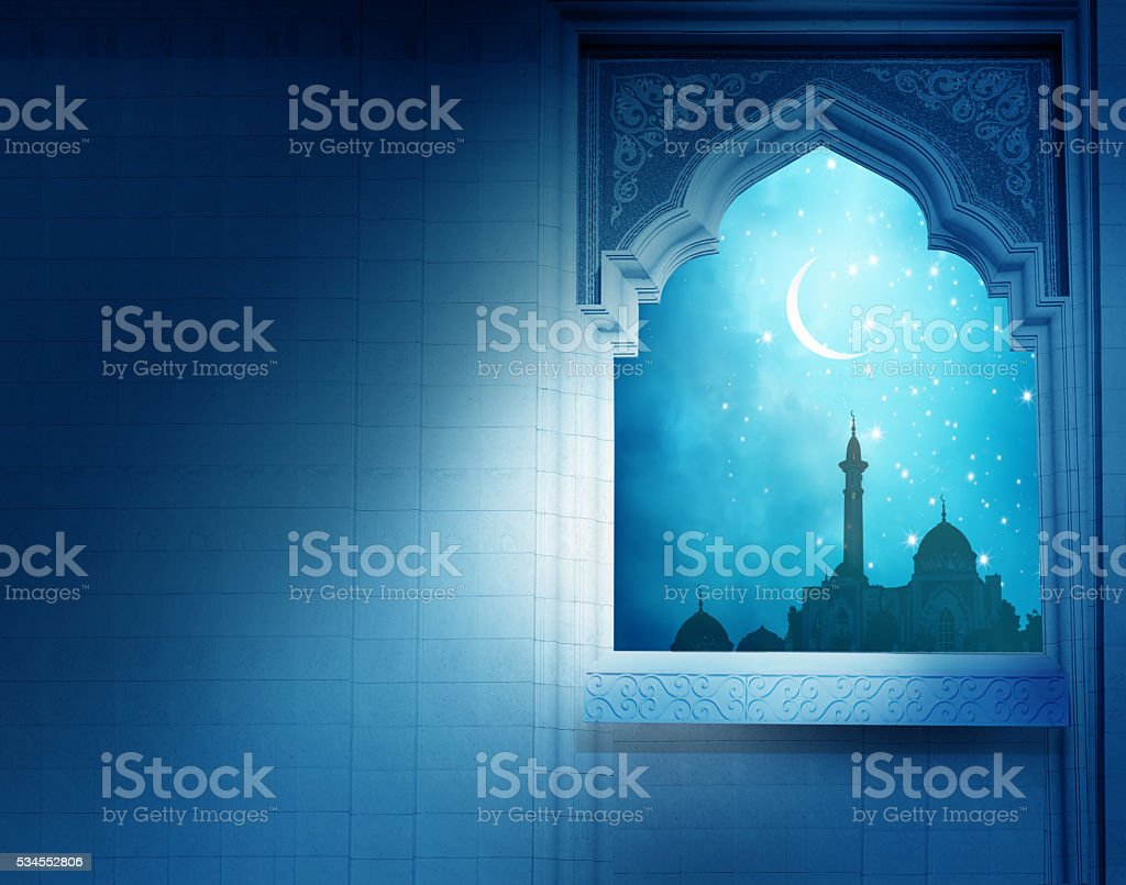 Ramadan Kareem background.Mosque window with shiny crescent moon stock photo