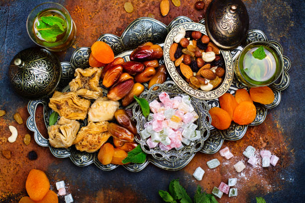 Ramadan Kareem holiday table Ramadan Kareem holiday table with dry fruits, nuts, dates, baklava. Eastern abundance. Copy space arabic style stock pictures, royalty-free photos & images