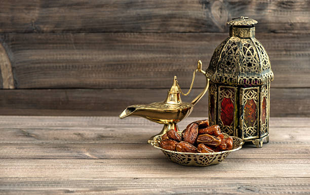 ramadan lamp and dates on wooden background. oriental lantern - ramadan stock photos and pictures