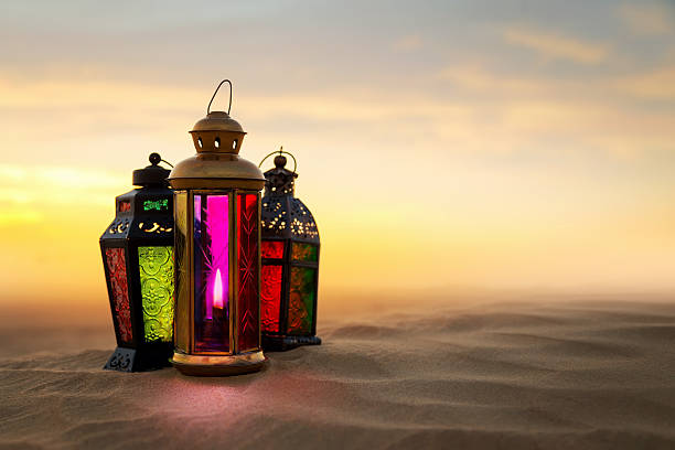 ramadan lantern on desert sand dunes - eid stock pictures, royalty-free photos & images