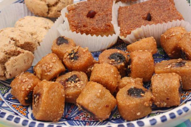 Cтоковое фото Ramadan pastry Kalb El louz Makrout Montecao
