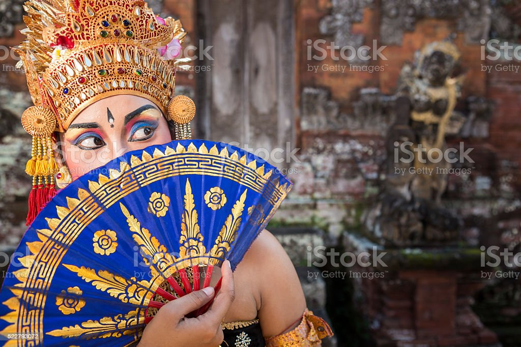 Ramayana Bali dancer with fan in a temple stock photo