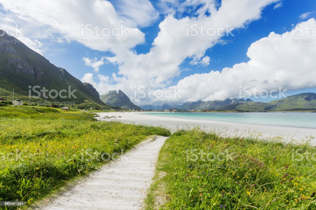 Rambergstranda beach on Lofoten islands. Beautiful sandy beach and azure water. Norway. - Royalty-free Bay of Water Stock Photo