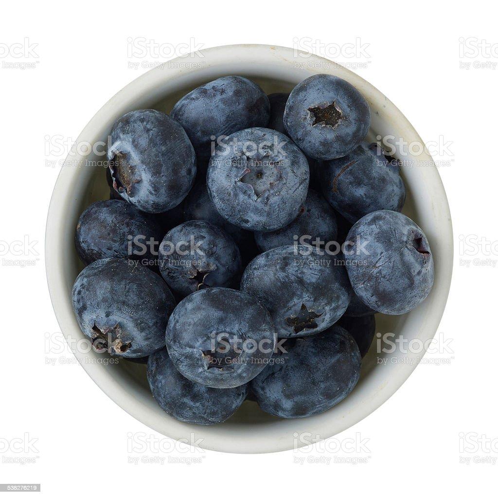 Ramekin of blueberries on a white background. stock photo