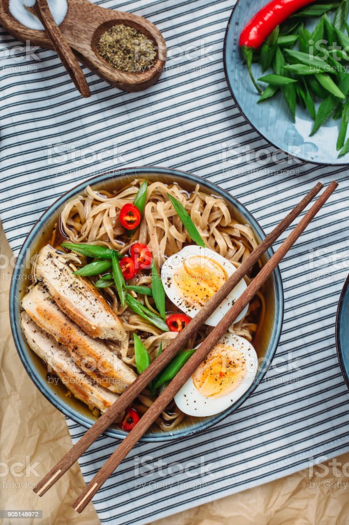 Ramen Noodle Soup with egg and chicken stock photo
