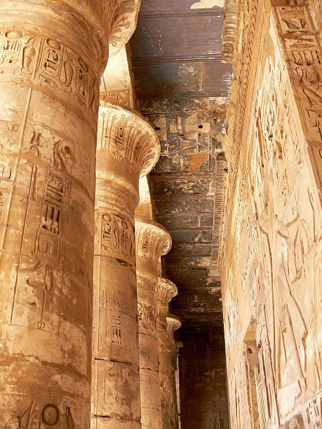 """Rameseum Temple """"Columns in Rameseum TempleNew Kingdom mortuary temple of Ramses II, partially destoyed in 27BC. Thre was once a 1200 Metric ton collosal statue of Ramses which now lies in pieces"""" Tomb Of Ramses III stock pictures, royalty-free photos & images"""