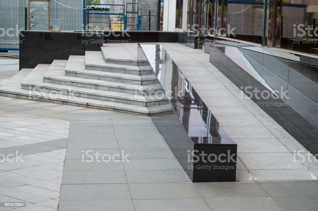 Ramp available to support wheelchair users in a modern office building, the facilities of transportation. stock photo