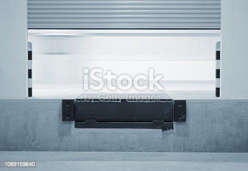 Ramp or dock leveller and shutter door.