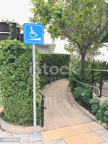 666724598 istock photo ramp for wheelchair and tower sign board 925332984