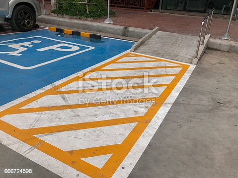 666724598istockphoto ramp in disable parking spot 666724598