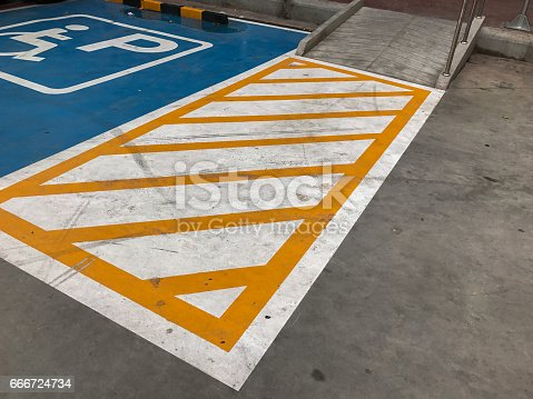 666724598 istock photo ramp in disable parking spot 666724734