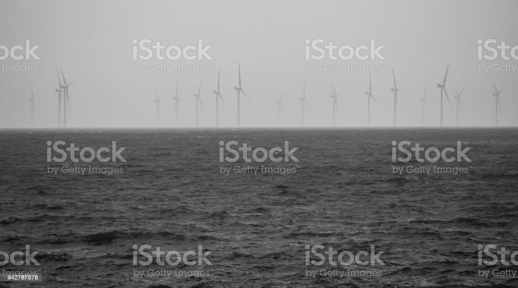Rampion Wind Faarm off the coast of Brighton looms out of the grey skies stock photo