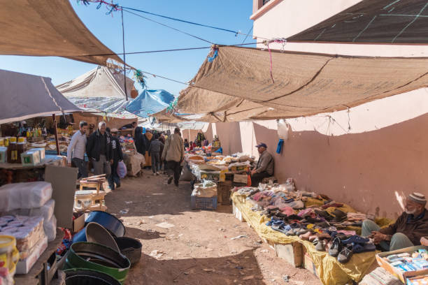 Ramshackle Berber market stalls selling shoes in Morocco stock photo