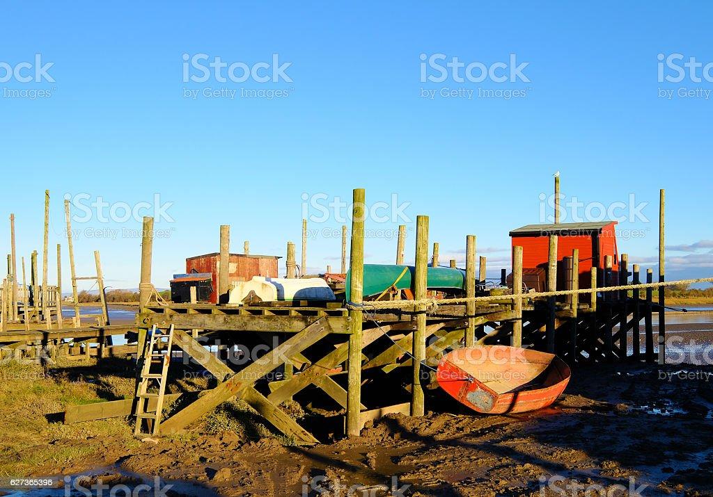 Ramshackle Boatyard on Mudflats stock photo