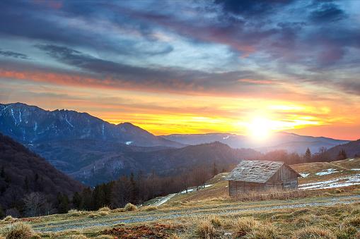 Majestic sunrise in the mountains and wooden hut,Ciucas mountains,Carpathians,Transylvania,Romania,Europe