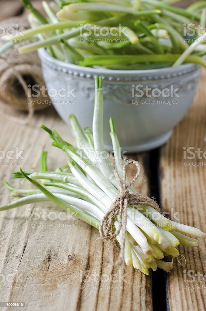 Ramson on a wooden table stock photo