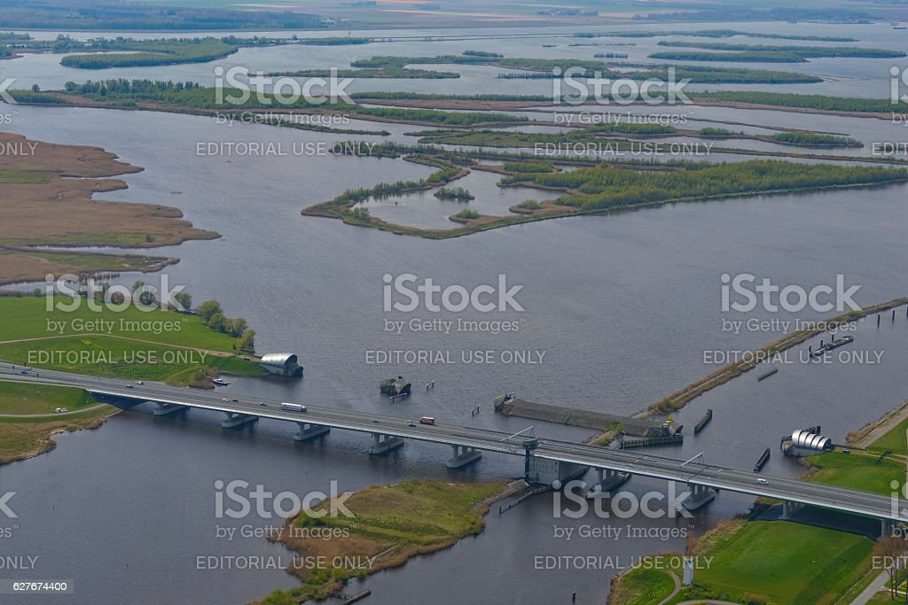 Ramspolbridge and storm barrier with IJssel delta in the background stock photo