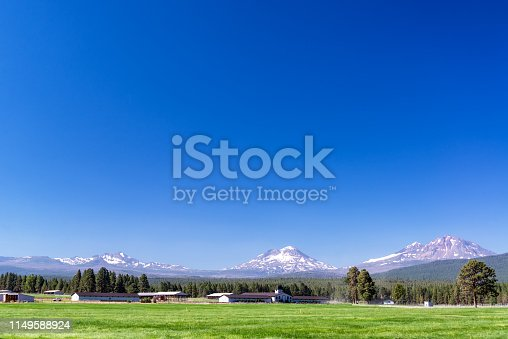 Ranch in Central Oregon with Three Sisters mountains in the background near Bend