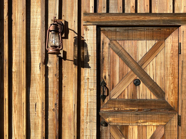 ranch cabin dutch door rusty lantern stock photo