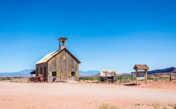 Ranch in the Wild West. The desert landscape of Utah and the old wooden barn Moab, Utah, USA - July 01, 2017: ancient ranch in the vicinity of the city of Moab, Utah, USA. An old barn, an animal enclosure and an old horse harness. Life in the Wild West of the USA. Attractions of the State of Utah frontier field stock pictures, royalty-free photos & images